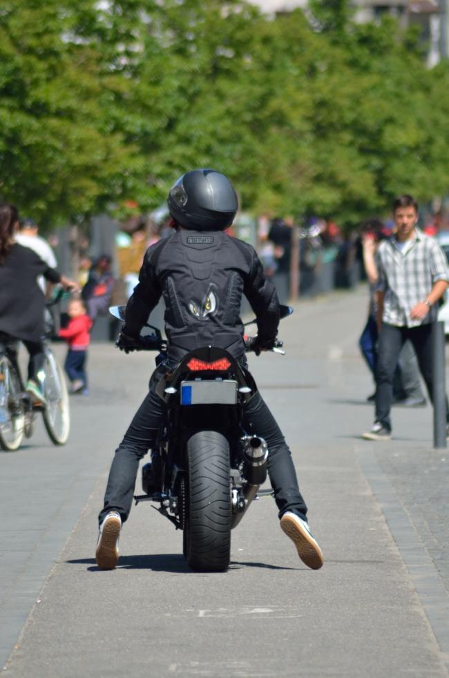 Biker with Helmet on the Road