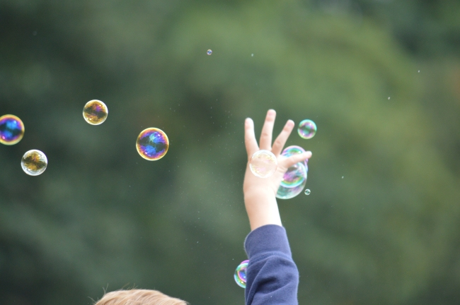 Child Catching Soap Bubbles