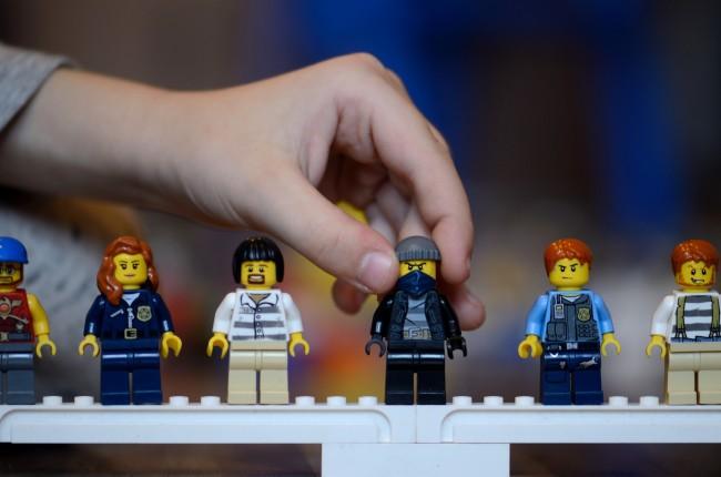 Child Handling LEGO People