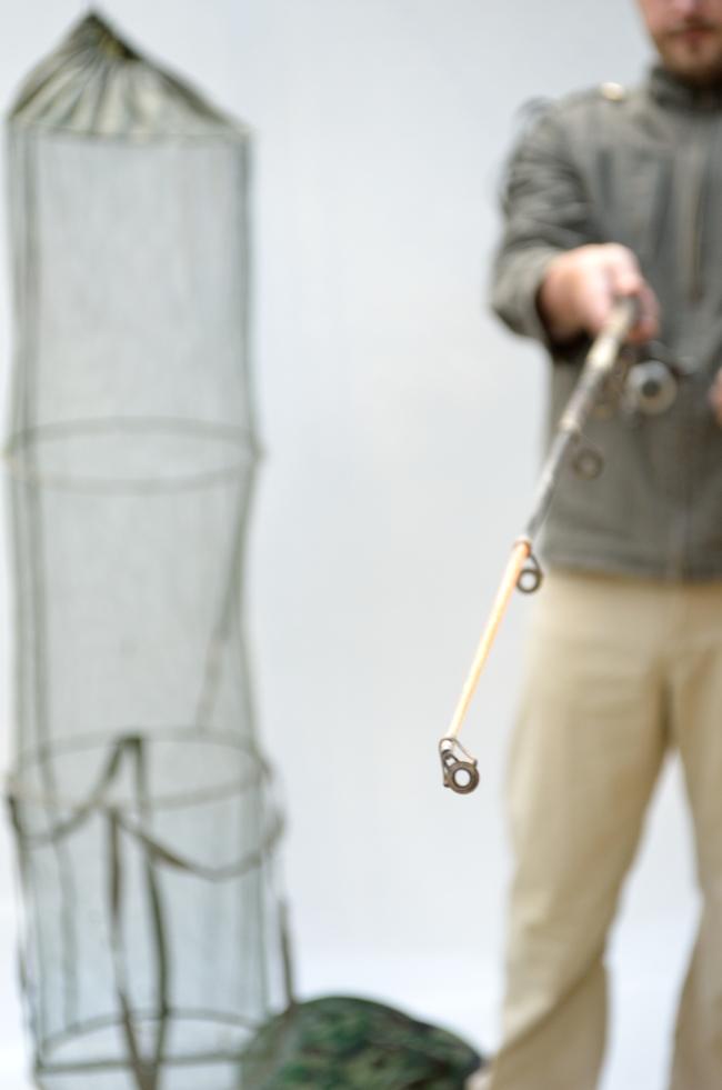 Fisherman Holding Fishing Rod